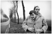American actor Mel Ferrer (1917 - 2008) buttons up his coat around his wife, actress Audrey Hepburn (1929-1993), on a country road outside Paris, 1956. (Photo by Michael Ochs Archives/Getty Images)