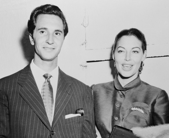 17 Aug 1954 --- Original caption: Movie Actress Ava Gardner appears with bullfighter Luis Miguel Dominguin at the Copagarage Night Club in New York. The two have romantically linked in newspaper stories. Miss Gardner has returned from Rio de Janeiro for the forthcoming premiere of her new Film The Barefoot Contessa. --- Image by © Bettmann/CORBIS